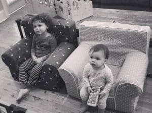 2 children sitting in best baby gear Pottery Barn Anywhere Chairs
