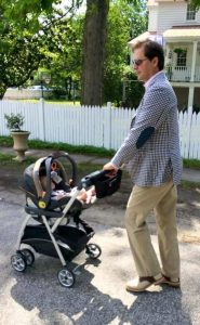 Father pushing baby in best Baby Gear Caddy Stroller