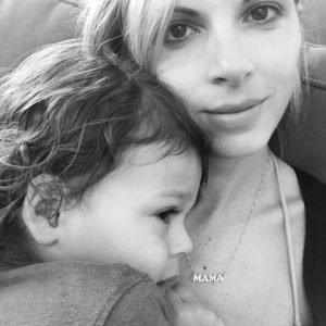 Stay at Home Mom snuggling sick child