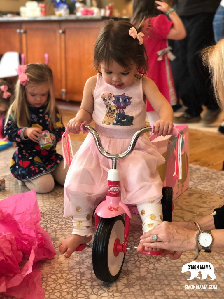 Puppy Dog Pals Birthday Party little girl riding Radio Flyer trike