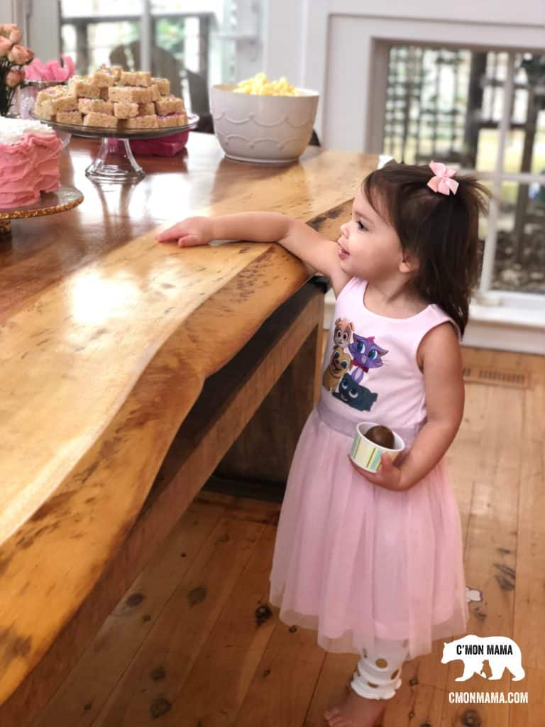 Puppy Dog Pals Birthday Party little girl looking at cake