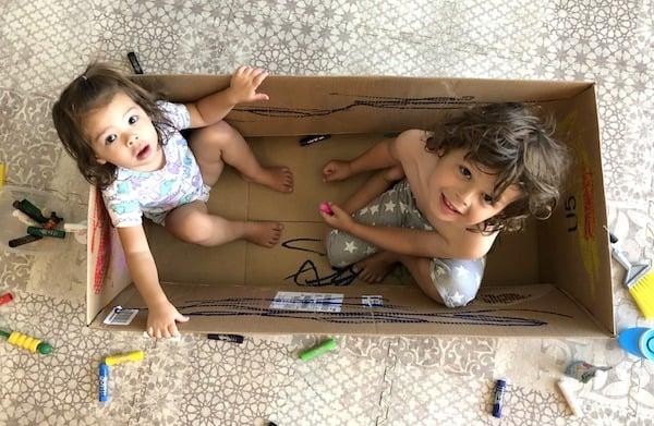 kwik stix paint crayons kids painting a big cardboard box