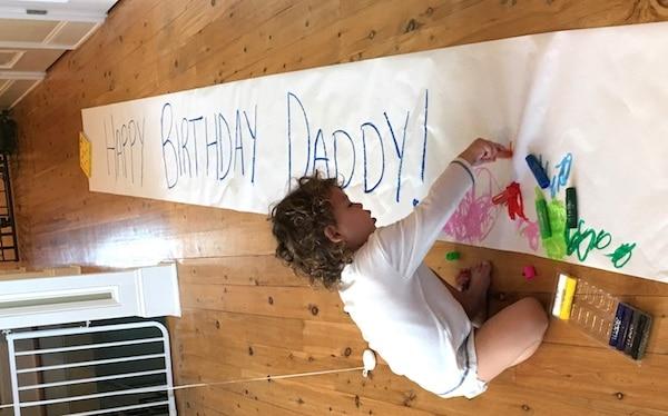 kwix stix paint crayons little boy making giant happy birthday banner