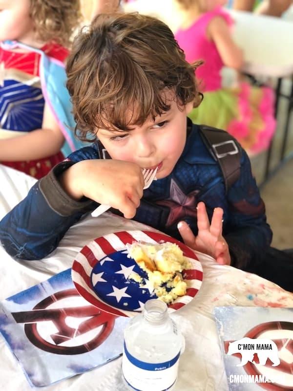 Superhero Birthday Party Kid eating cake