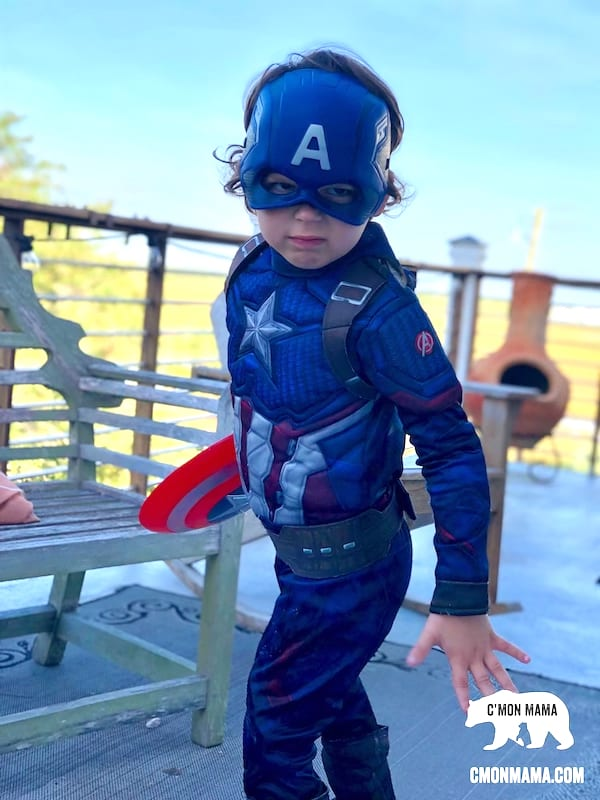 Superhero Birthday Party little boy in superhero costume